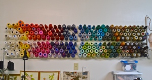 The $2,000 wall of 35-text spools of thread. Big money, high quality, apparently.