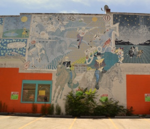 An eye-catching mural decorating the side of a pet store.